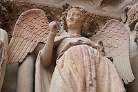Smiling angel, late 13th - early 14th centuries, from an Annunciation scene in the central portal on the Western facade of the Cathedrale Notre-Dame de Reims or Reims Cathedral, Reims, Champagne-Ardenne, France. The cathedral was built 1211-75 in French Gothic style with work continuing into the 14th century, and was listed as a UNESCO World Heritage Site in 1991. Picture by Manuel Cohen