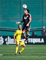 Dwayne De Rosario (7) of D.C. United heads the ball during the game at RFK Stadium in Washington, DC.  Columbus Crew defeated D.C. United, 2-1.