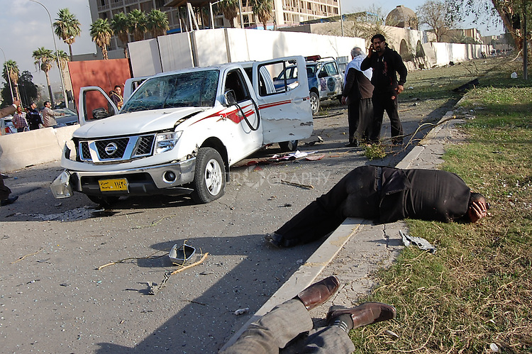 BAGHDAD, IRAQ:  Wounded people lay on the ground after an explosion outside the Sheraton Hotel, January 25, 2010...At least 36 people have died in three large explosions apparently targeting hotels in the heart of Iraq's capital..More than 70 people were injured in the Baghdad blasts, which officials said were caused by suicide car bombers.  They struck near the Sheraton, Babylon and Hamra hotels, which are popular with Western businessmen and media....Photo by Qeas Kazm/Metrography