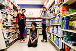NEW YORK -- SEPTEMBER 20, 2006: The Klaxons-- James Righton (L), Simon Taylor (C) and Jamie Reynolds (R)-- pose for a portrait in a pharmacy before performing at Club Midland on September 20th, 2006 in New York City.  (PHOTOGRAPH BY MICHAEL NAGLE)