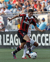 AC Milan substitute midfielder Mattia Valoti (57) dribbles as C.D. Olimpia forward Juan Ramon Mejia (17) defends. In an international friendly, AC Milan defeated C.D. Olimpia, 3-1, at Gillette Stadium on August 4, 2012.