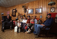 December 1976. Plains, Georgia. White farmers gathered in thier home in Plains.
