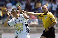 UNAM Pumas striker Jose Luis Lopez celebrates after scoring a goal against Chiapas Jaguares as the referee Mauricio Morales looks on during their soccer match at the University Stadium, April 02, 2006. UNAM Pumas won 2-1 to Chiapas Jaguares. Photo by © Javier Rodriguez