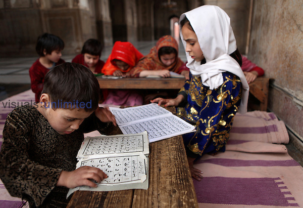 Children studying in the Badshahi Mosque, Lahore, Pakistan