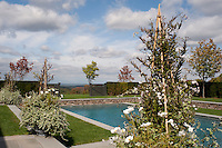 The outdoor swimming pool benefits from stunning views of the surrounding countryside