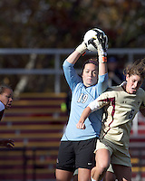 Florida State goalkeeper Kelsey Wys (19) collects shot off crossbar, beating Boston College defender Alyssa Pember (6). Florida State University defeated Boston College, 1-0, at Newton Soccer Field, Newton, MA on October 31, 2010.
