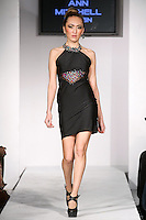 Model walks runway in an outfit from the Ann Mitchell Little Black Dress Collection by, Ann Mitchell during BK Fashion Weekend Fall Winter 2012.