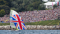 ENGLAND, Weymouth. 8th August 2012. Olympic Games. 49er class, medal race. Stephen Morrison (GBR) Helm, Ben Rhodes (GBR) Crew sail in front of the spectators on the Nothe.