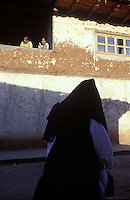 Two women look on as Jesus´crucifiction is re-enacted for holy week (Semana Santa) in Erongaricuaro, Michoacan, Mexico