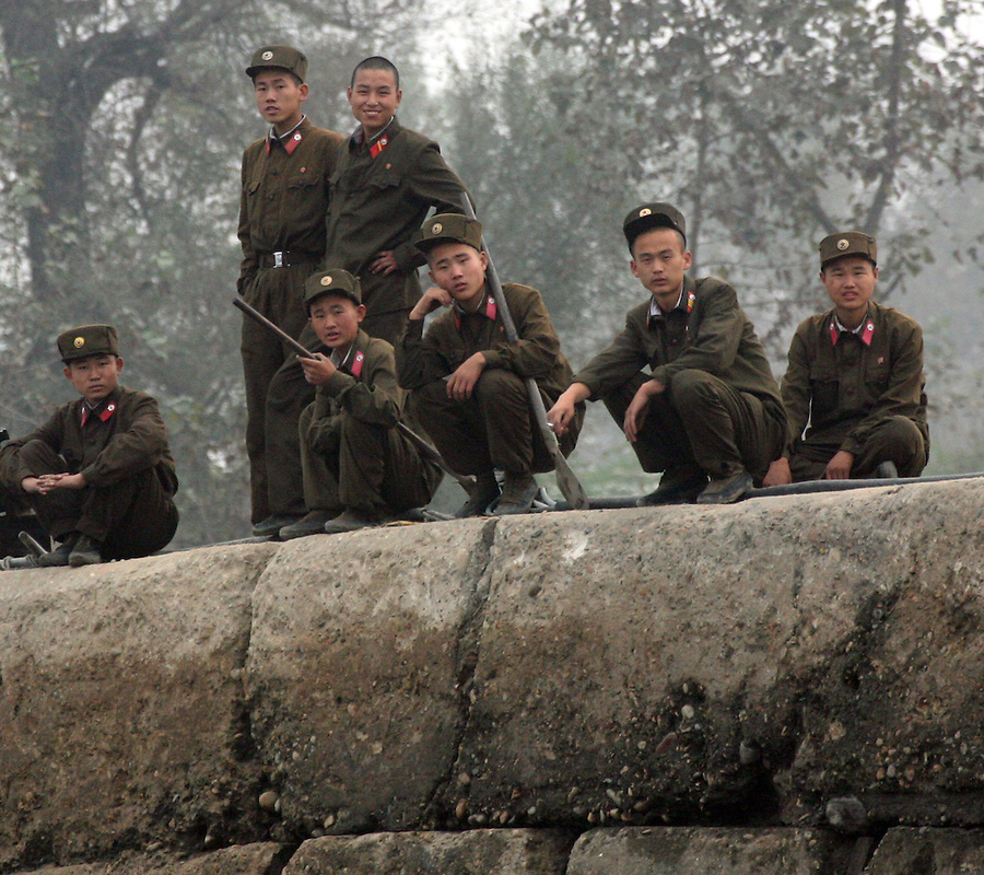 North Koreans soldiers on a pier in the town of Sunuiju October 10 DPRK, north korea, china, dandong, border, liaoning, democratic, people's, rebiblic, of, korea, nuclear, test, rice, japan, arms, race, weapons, stalinist, communist, kin jong il