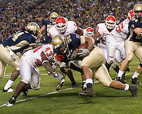 21 October 2006: Pitt running back Conredge Collins (30) collides with Rutgers safety Ron Girault (43)..The Rutgers Scarlet Knights defeated the Pitt Panthers 20-10 on October 21, 2006 at Heinz Field, Pittsburgh, Pennsylvania.