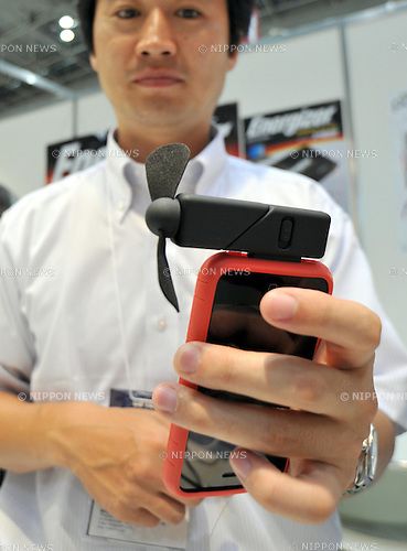 July 6th, 2011, Tokyo, Japan - A small electric fan gives its user a nice breeze when attached to an iPhone as the gadget is being demonstrated during the 22nd International Stationery and Office Products Fair in Tokyo on Wednesday, July 6, 2011. (Photo by Natsuki Sakai/AFLO) [3615] -mis-.