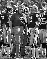 Oakland Raider coach John Madden with quarterback Ken Stabler during a time out. (1974  photo by Ron Riesterer)