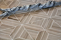 Truman, a stone waterjet mosaic shown in Driftwood polished, is part of the Parquet Line by Sara Baldwin for New Ravenna Mosaics.