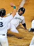 21 August 2010: Vermont Lake Monsters' outfielder Kevin Keyes slides home safely in the 5th inning against the Brooklyn Cyclones at Centennial Field in Burlington, Vermont. The Cyclones defeated the Lake Monsters 8-7 in a 12-inning game that had to be resumed in Brooklyn on August 31 due to late inning rain. Mandatory Credit: Ed Wolfstein Photo