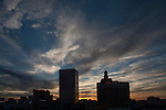 Looking up at blue sky panorama with cloud formation in late afternoon just before sunset in Atlantic City, NJ