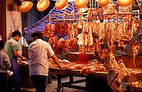 Hong Kong.  China.  Butcher's stall in open air market.