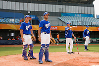 17 August 2007: Catchers Boris Marche and Jamel Boutagra practice, next to Jeff Zeilstra and Patrick Carlson during the Good Luck Beijing International baseball tournament (olympic test event) at the Wukesong Baseball Field in Beijing, China.
