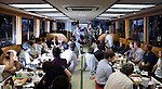 """Customers enjoy dinner and entertainment aboard a """"Yakata-bune"""" pleasure boat run by the Yasuda family in Tokyo, Japan on 30 August  2010. .Photographer: Robert Gilhooly"""