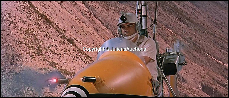BNPS.co.uk (01202 558833)<br /> Pic: JuliensAuctions/BNPS<br /> <br /> ***Please Use Full Byline***<br /> <br /> The gyrocopter flown by Sean Sonnery in the James Bond film, You Only Live Twice. <br /> <br /> The iconic micro-jet flown by Roger Moore in Octopussy and the swivel chair used by super-villain Blofeld are among a host of props from James Bond movies coming up for sale.<br /> <br /> The 12ft long BD-5J red, white and blue aircraft, that is the world's lightest jet, was piloted by 007 in the opening scenes of Octopussy, outwitting his Cuban captors.<br /> <br /> The aircraft was actually built seven years before the film as part of an air display team and was hired for the 1983 Bond flick.