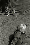 A boxer dog and man at a carnival in London.<br /> [This photograph is currently licensed through GalleryStock - please contact the photographer for details]