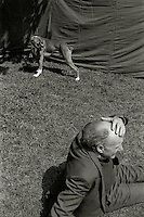 A boxer dog and man at a carnival in London.<br />
