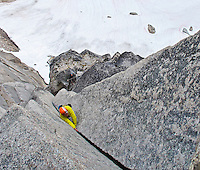 Tim, from the Netherlands climbs the stellar 4th pitch of McTech Arete, 5.10a, on Crescent Spire, Bugaboo Provincial Park, British Columbia, Canada.