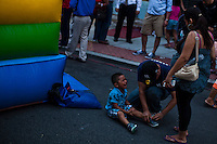 A child cries after leaving a child game during the National Night Out festivities in Union City, New Jersey, Aug 6, 2013. Photo by Eduardo Munoz Alvarez / VIEWpress.