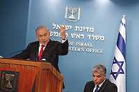 Israel's Prime Minister Benjamin Netanyahu (L), and Finance Minister Yair Lapid during a press conference in his office, speaking about the reform in Israel's seaports, in Jerusalem, on July 3, 2013.   Photo by Oren Nahshon
