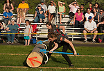 BEACON FALLS,  CT-051917JS16- With the crowd looking on, Wamogo's Brooke Healy and Tori Ross compete in the log roll during the Axe Games with Woodland Friday at Woodland Regional High School in Beacon Falls.<br />  Jim Shannon Republican-American
