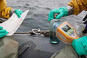 Crew from the Greenpeace ship Rainbow Warrior collect sea water samples to monitor radiation contamination levels, as the ship sails up the eastern coast of Japan, in the vicinity of Fukushima, in Japan, Tuesday 3rd May 2011..Collecting a sample of seawater at coordinates 36' 58.593 North, 141' 23.685 East.