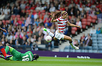 Glasgow, Scotland - Saturday, July 28, 2012: Alex Morgan of the USA Women's soccer team vaults over Colombia goalkeeper Sandra Sepulveda during a USA 3-0 win over Colombia in the first round of the Olympic football tournament at Hamden Park.
