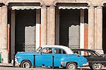 Havana, Cuba; a classic blue and white 1952 Chevy waiting in traffic along the Paseo de Marti (Prado)