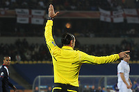 Brazilian referee Carolos Simon signals a free kick during the USA-England match. The U.S. and England played to a 1-1 draw in the opening match of Group C play at Rustenburg's Royal Bafokeng Stadium, Saturday, June 12th.