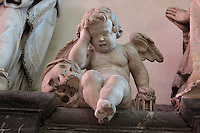 Crying angel sculpture, with skull and hourglass, 1636 by Nicolas Blasset, 1600-59, French sculptor, from the tomb of canon Guilain Lucas, died 1628, behind the choir in the Basilique Cathedrale Notre-Dame d'Amiens or Cathedral Basilica of Our Lady of Amiens, built 1220-70 in Gothic style, Amiens, Picardy, France. Amiens Cathedral was listed as a UNESCO World Heritage Site in 1981. Picture by Manuel Cohen