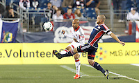 D.C. United substitute midfielder Kyle Porter (19) clears the ball.  In a Major League Soccer (MLS) match, the New England Revolution (blue) defeated D.C. United (white), 2-1, at Gillette Stadium on September 21, 2013.
