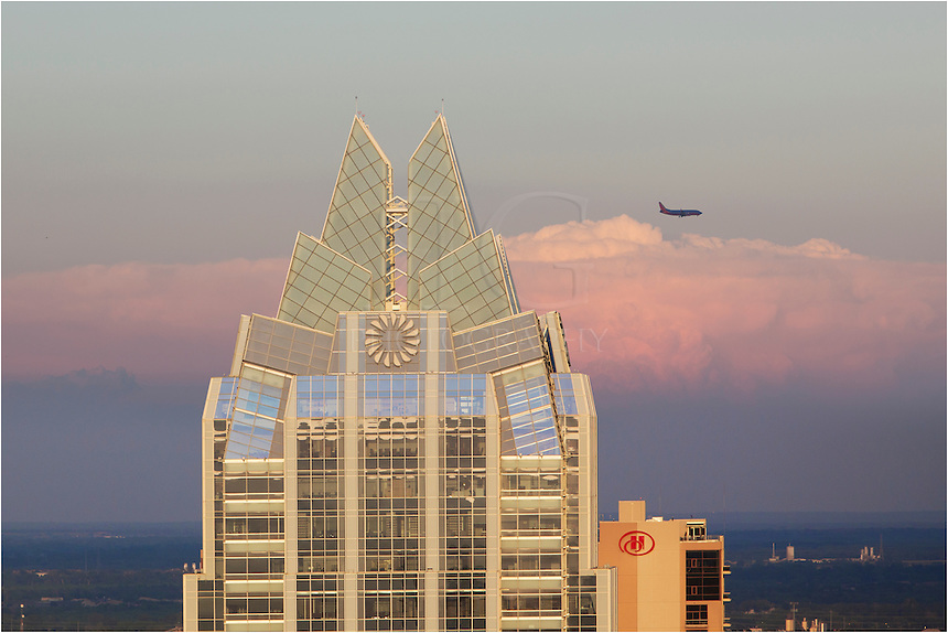 Using a telephoto lens from the Springs Condominiums, this Austin Skyline image focuses on the Frost Tower. A huge thunderstorm was brewing in the distance and the airplanes were approaching from north. I caught this Southwest Airlines plan coming in for a landing between the Frost Tower and the thunderhead in the distance... taken just at sunset.