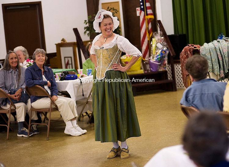 OXFORD--10 May 2008--051008TJ02 - Sandra Behuniak Tarbox, center, in clothes styled after the 1780s, jokes with her audience as she talks about the role that clothes played and what they revealed about people during the Revolutionary War era at the Oxford Historical Society's annual Spring Tea at the Great Hill United Methodist Church on Saturday, May 10, 2008. Tarbox grew up in Oxford, but now lives in Newmarket, N.H. (T.J. Kirkpatrick/Republican-American)