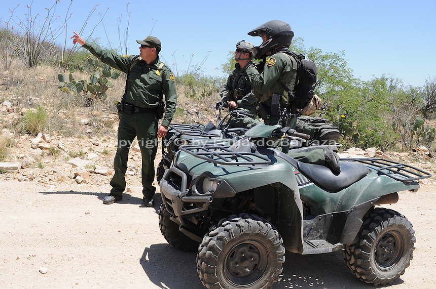 Sasabe, Arizona – Border Patrol agents from a special unit receive instructions before participating in an event that took a group of journalists to a walk through the desert. This area is located near the Sasabe Port of Entry, a border-crossing station located in southern Arizona, and about 70 miles from the City of Tucson. Sasabe is one of the most isolated ports along the 2,000-mile U.S.-Mexico border, and it connects the towns of Sasabe, Arizona and El Sasabe, Sonora (Mexico). The border-crossing station is located in one of the busiest human and drug smuggling corridors of the U.S.-Mexico border. U.S. Customs Border Protection (CBP) transported journalists to this remote area where they walked through a 1.3 miles trail during a two-day event organized by the Tucson Sector Border Patrol. The event brought national and international journalists to the Arizona desert to become acquainted with the dynamics of this area. Photo by Eduardo Barraza © 2012