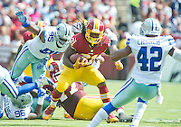 Washington Redskins running back Matt Jones (31) carries the ball during second quarter action against the Dallas Cowboys at FedEx Field in Landover, Maryland on Sunday, September 18, 2016.  Dallas Cowboys defensive tackle David Irving (95) and strong safety Barry Church (42) pursue on the play.<br /> Credit: Ron Sachs / CNP /MediaPunch
