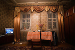 Gold silk drapes and gold-tinted wallpaper decorate the sitting room of a village house in Ivanovka on Oct. 29, 2009.