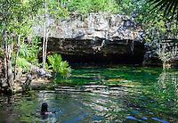 Swimmer in the Chikin Ha Cenote, Playa del Carmen, Riviera Maya, Yucatan, Mexico.