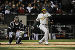 CHICAGO - APRIL 12:  Coco Crisp #4 of the Oakland Athletics bats against the Chicago White Sox on April 12, 2011 at U.S. Cellular Field in Chicago, Illinois.  The White Sox defeated the Athletics 6-5.  (Photo by Ron Vesely)  Subject:  Coco Crisp