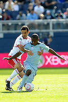 Red Bulls midfielder Rafael Marquez (4) challenges for the ball in midfield with Julio Cesar (55) Sporting KC...Sporting Kansas City defeated New York Red Bulls 2-0 at LIVESTRONG Sporting Park, Kansas City, Kansas.