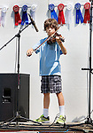 ROXBURY CT. 11 July 2015-071115SV04-Ian Fernandes, 11, of Woodbury plays during the annual Pickin' 'N' Fiddlin' fundraiser at Hurlburt Park in Roxbury Saturday.<br /> Steven Valenti Republican-American