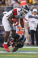 Towson, MD - September 9, 2016: St. Francis (Pa) Red Flash running back Marcus Bagley (2) is tackle by a Towson Tigers defender during game between Towson and St. Francis at Minnegan Field at Johnny Unitas Stadium  in Towson, MD. September 9, 2016.  (Photo by Elliott Brown/Media Images International)