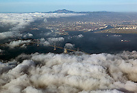 aerial photograph from San Francisco covered in fog to Oakland and Mount Diablo, California