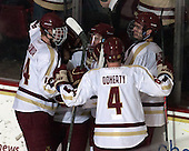 The Eagles celebrate Ryan Fitzgerald's (BC - 19) goal. - The visiting University of Notre Dame Fighting Irish defeated the Boston College Eagles 7-2 on Friday, March 14, 2014, in the first game of their Hockey East quarterfinals matchup at Kelley Rink in Conte Forum in Chestnut Hill, Massachusetts.