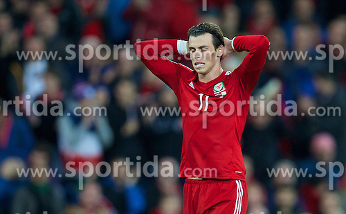 13.10.2014, City Stadium, Cardiff, WAL, UEFA Euro Qualifikation, Wales vs Zypern, Gruppe B, im Bild Wales' Gareth Bale looks dejected after missing a chance against Cyprus // 15054000 during the UEFA EURO 2016 Qualifier group B match between Wales and Cyprus at the City Stadium in Cardiff, Wales on 2014/10/13. EXPA Pictures &copy; 2014, PhotoCredit: EXPA/ Propagandaphoto/ David Rawcliffe<br /> <br /> *****ATTENTION - OUT of ENG, GBR*****