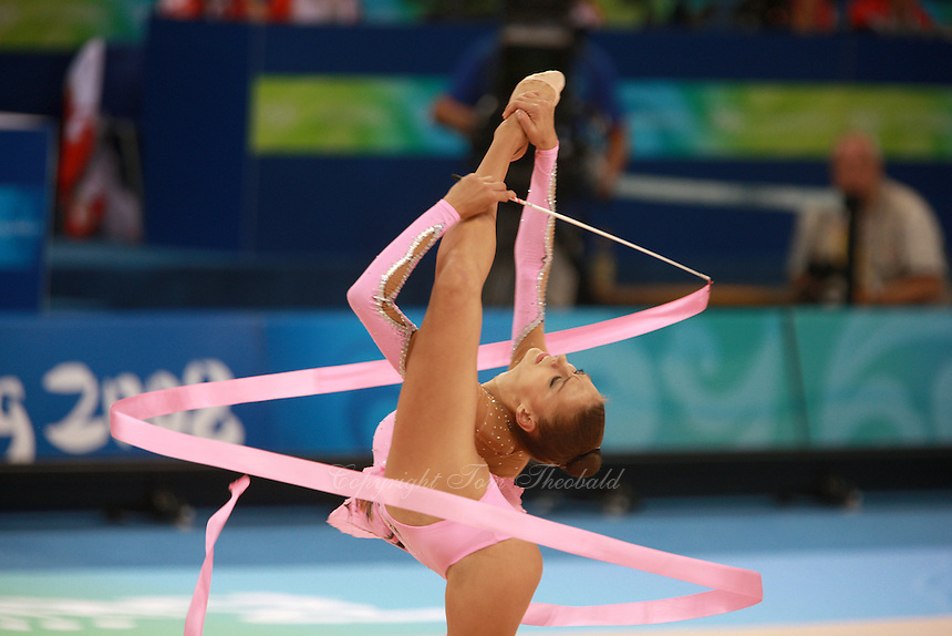 August 23, 2008; Beijing, China; Rhythmic gymnast Evgenia Kanaeva of Russia turns pirouette with ribbon on way to winning gold in the All-Around final at 2008 Beijing Olympics..(©) Copyright 2008 Tom Theobald